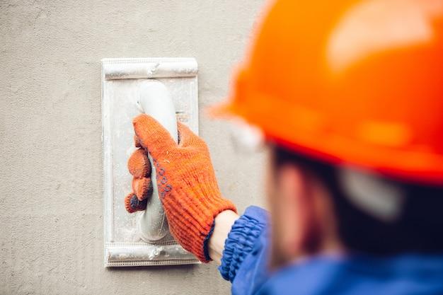 Close up of hand of repairman, professional builder working indoors, repairing Free Photo