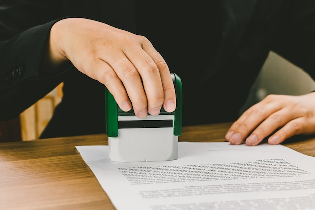 Premium Photo | Close-up hand stamping of businesswoman for signing  approval on documents