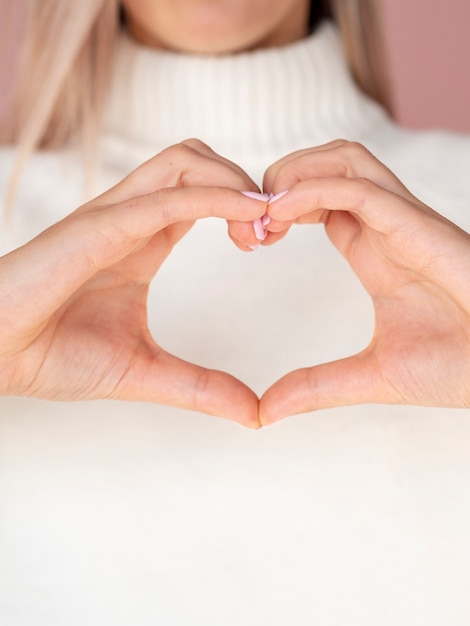 Close up of hands gesturing heart Free Photo