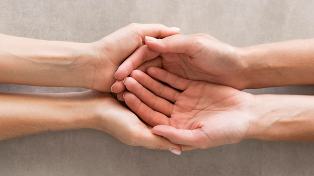 Close-up hands holding each other Premium Photo