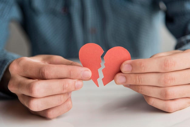 Close-up hands holding heart pieces Free Photo