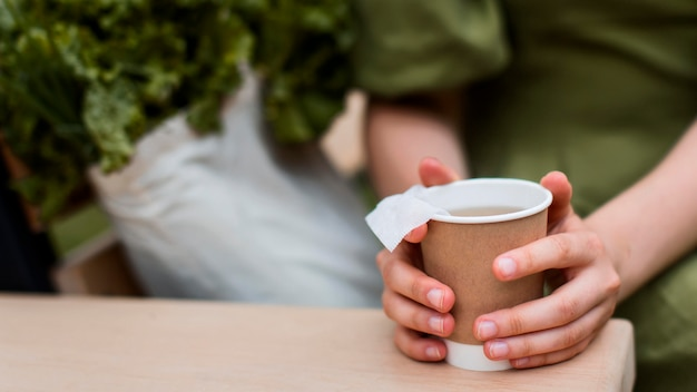 Close-up hands holding organic cup of tea Free Photo