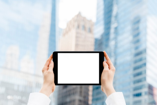 Close-up hands holding a tablet mock-up Free Photo