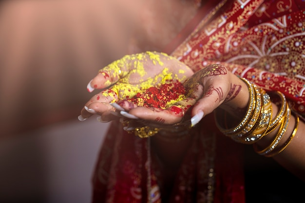 Close-up hands of india girl holding colorful powder in hands at holi festival Premium Photo