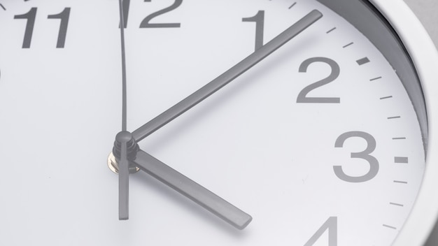 Close-up of hands on white clock face Free Photo
