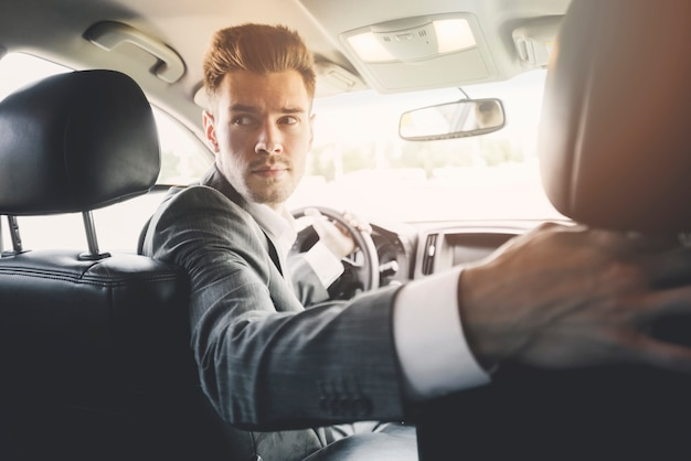 Close-up of handsome man driving reverse Free Photo