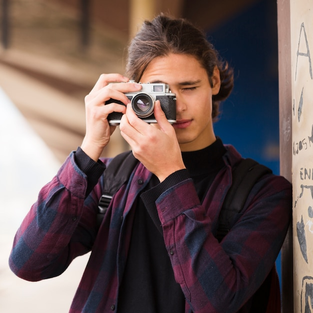 Close-up handsome man taking a picture Free Photo