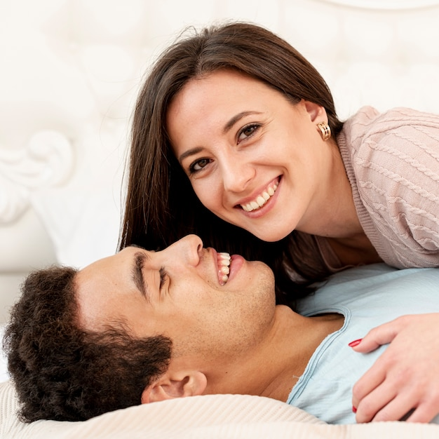 Close-up happy couple in the bedroom Free Photo