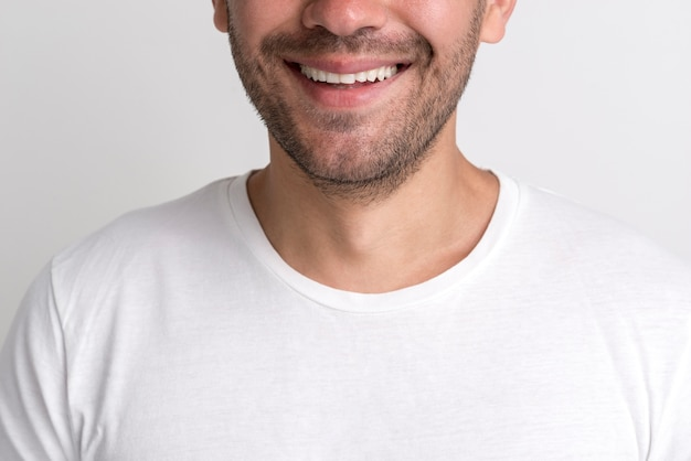 Close-up of happy stubble young man against white backdrop Free Photo