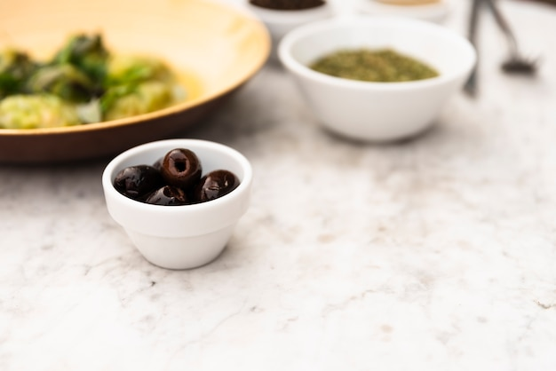 Close-up of healthy olive in small bowl Free Photo