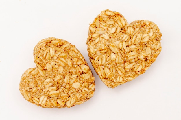 Close-up heart shaped cereal on white background Free Photo