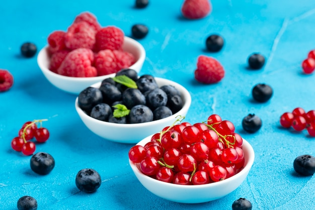 Close-up high angle view of bowls of berries Free Photo
