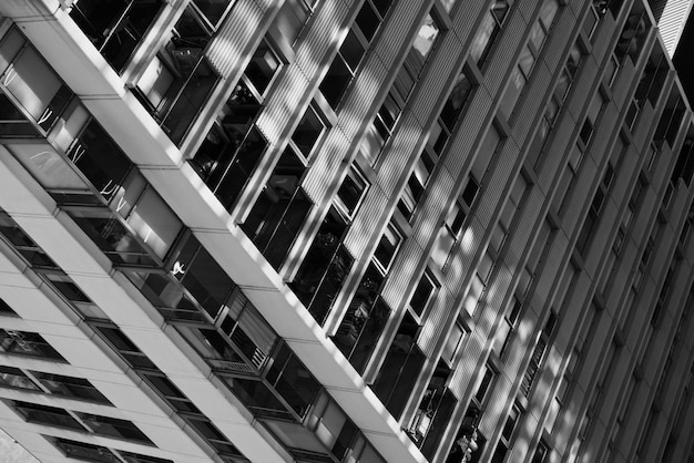 Close-up high-rise building in black and white Free Photo