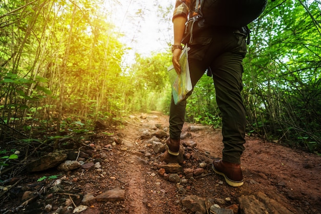 Close up hiking man with trekking boots walking in the forest Premium Photo
