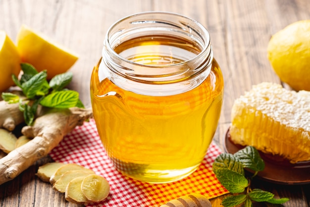 Close up honey jar with honeycomb Free Photo
