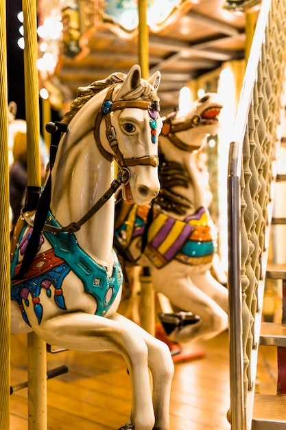 Close-up of horse ride in carousel at amusement park Free Photo