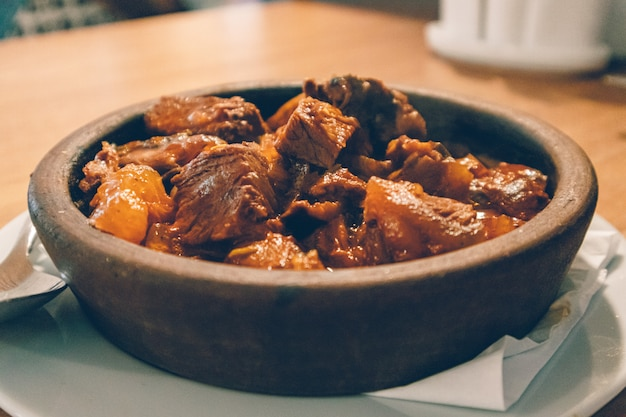 Close up of hot beef stew served in clay bowl. Premium Photo