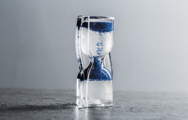 Close up hourglass on table Premium Photo