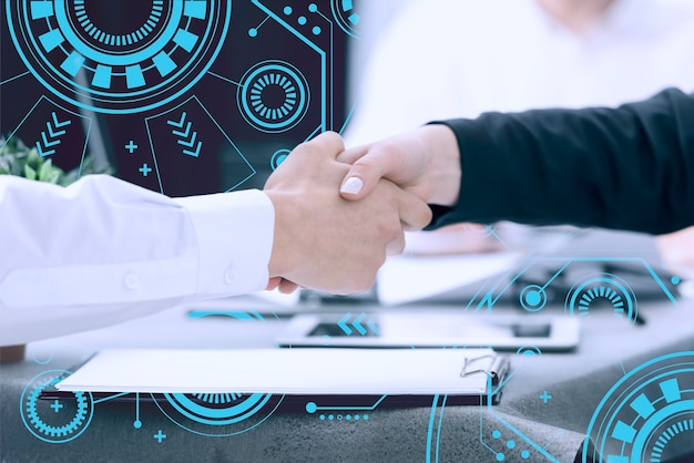 Close-up of humans handshake with tech background Premium Photo
