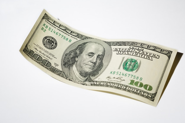 Close up hundred dollar banknote on white Premium Photo