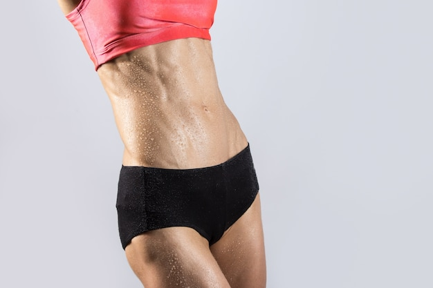 Close-up of ideal sexy sweating abs of beautiful athletic woman Free Photo