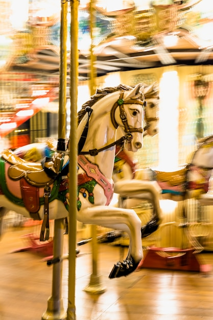 Close-up of an illuminated detail carousel horses Free Photo