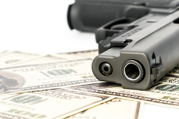 Close up image of pistol and dollar . Free Photo