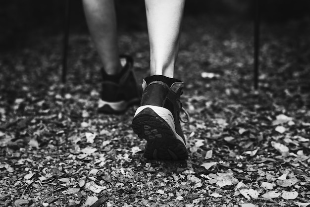 Close-up image of woman wearing trekking shoes Free Photo