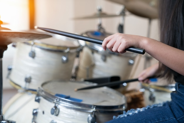 Close up images of girl playing drum. Premium Photo