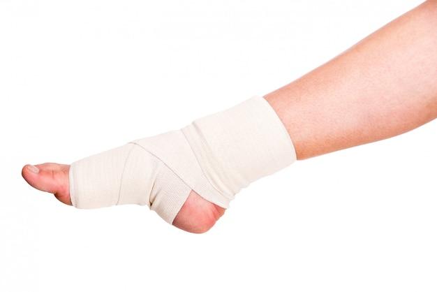 Close-up of injured ankle with bandage. Premium Photo