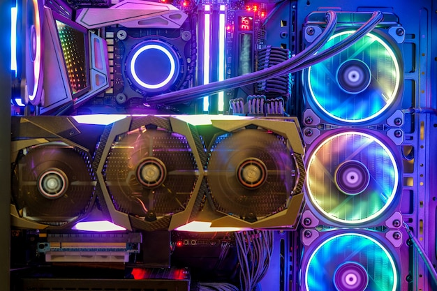 Premium Photo | Close-up and inside desktop pc gaming and cooling fan cpu  with multicolored led rgb light show status on working mode, interior pc  case technology background