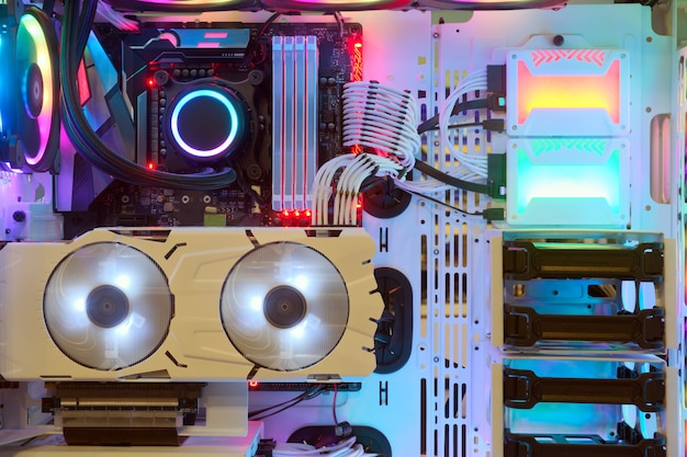 Close-up and inside desktop pc gaming and cooling fan cpu with multicolored led rgb light show status on working mode Premium Photo