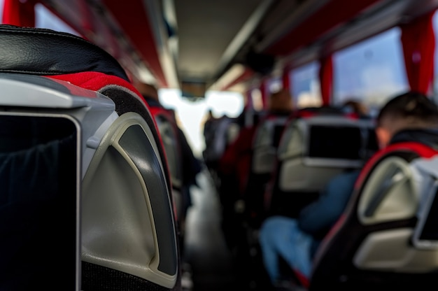 Close-up of inside travel bus with passengers on road trip. transport, tourism, road trip and people concept. selective focus Premium Photo