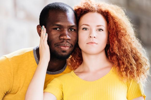 Close-up of interracial couple facing the camera Free Photo