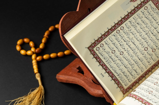 Close-up islamic new year with quran book Free Photo