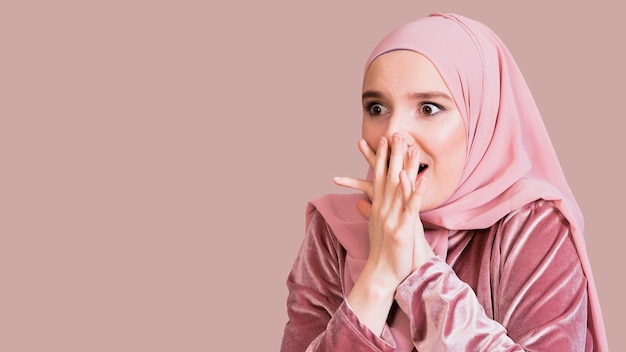 Close-up of a islamic woman with surprised expression Free Photo