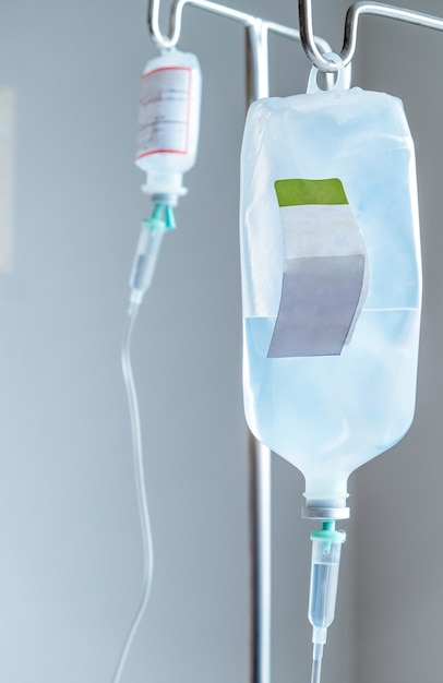 Close up of iv saline solution drip for patient in hospital Premium Photo