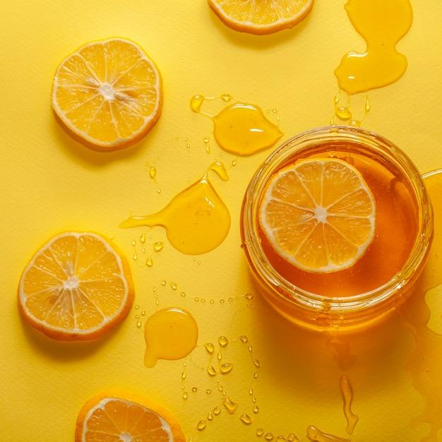 Close-up jar with honey and lemon Free Photo