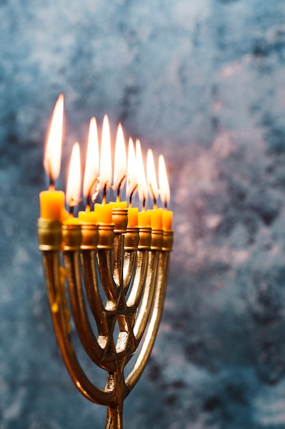 Close-up jewish candleholder burning Free Photo