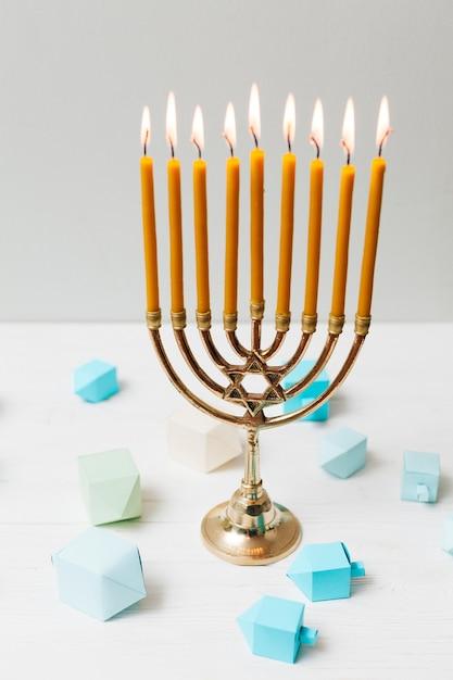 Close-up jewish candleholder for hanukkah Free Photo