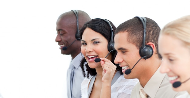 Close-up of joyful business people working in a call center Premium Photo