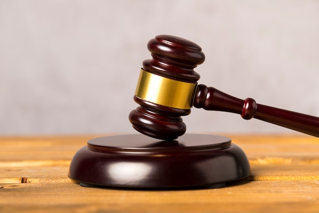 Close-up judge gavel with wooden stand Free Photo