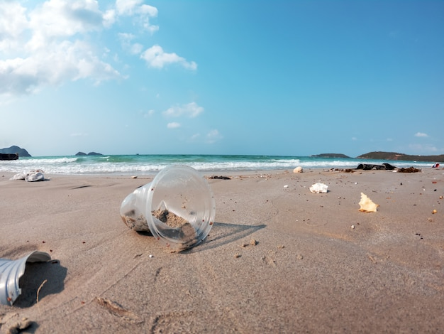 Close up of junk garbage dirty on the beach environment pollution background. Premium Photo