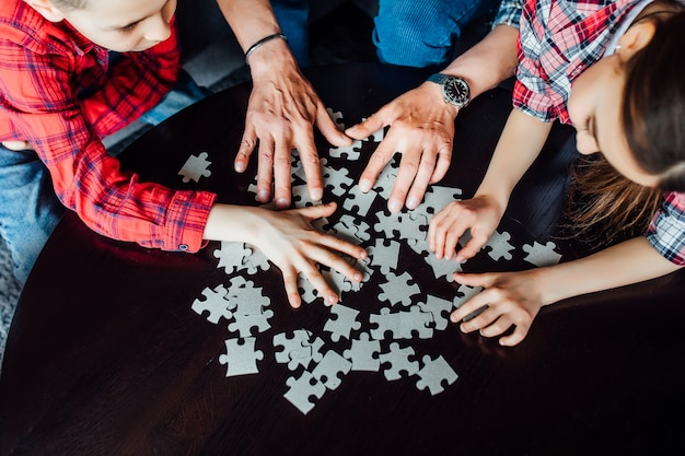 Close up . kids hands assembling puzzle. Premium Photo