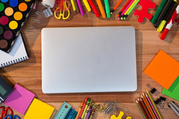 Close-up of laptop with various stationery Free Photo