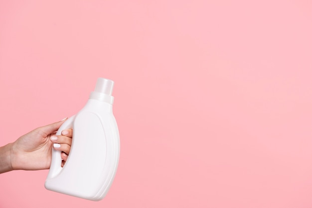 Close-up laundry detergent with pink background Free Photo