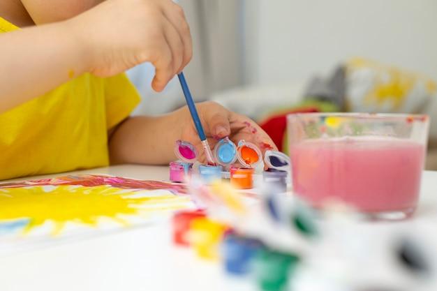 Close-up little boy painting Premium Photo