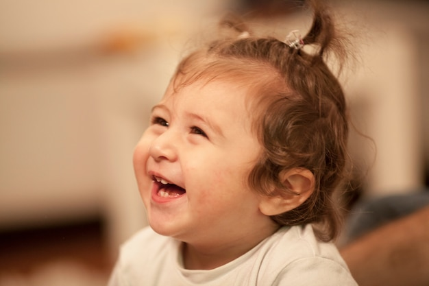 Close-up of little girl laughing Free Photo