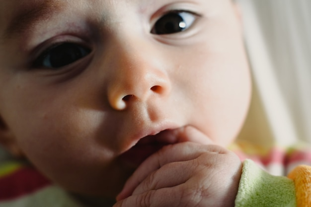 Close-up of the look of a funny baby. Premium Photo
