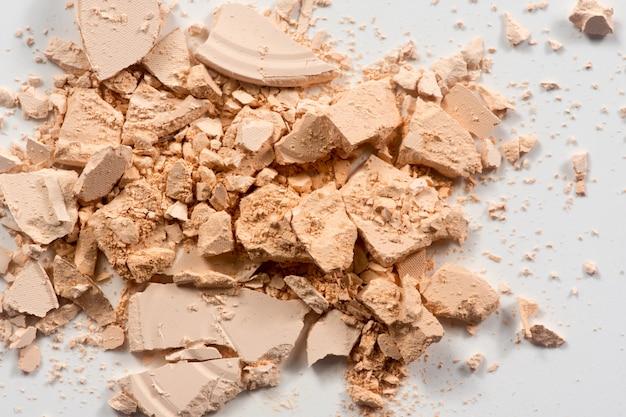 Close up of make up powder on white background. Premium Photo